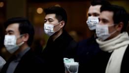 Protecci�n contra la alta poluci�n en ciudades china. FOT�GRAFO: CARLOS BARRIA | REUTERS