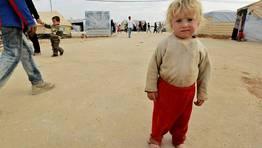 Un ni�o sirio en el campo de refugiados de Al-Zaatri, cerca de la ciudad jordana de Mafraq. FOT�GRAFO: MUHAMMAD HAMED | Reuters